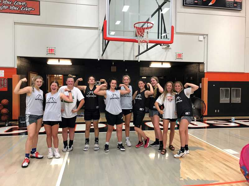 COURTESY PHOTO: SARAH MANN - Scappoose basketball players make goofy faces and show off their weight-room gains.
