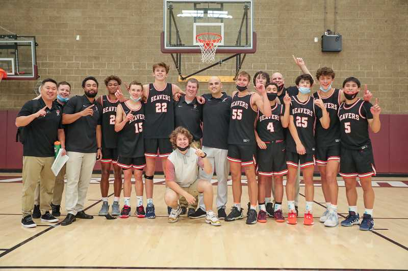 PMG PHOTO - The Beaverton Beavers boys basketball team poses for a picture after the conclusion of their Red Bracket final win over Grant Thursday, June 24, at Franklin High School.