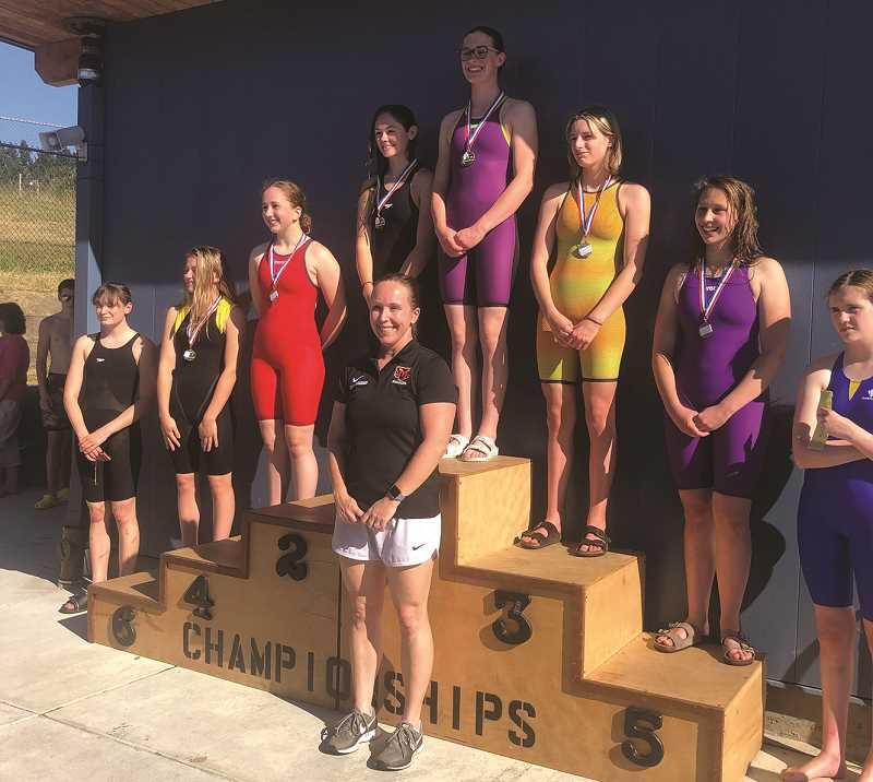 COURTESY PHOTO: MELISSA GEORGESEN - Marie Mason stands on the top of the podium after her state championship-winning swim in the 500 freestyle at the 4A state meet.