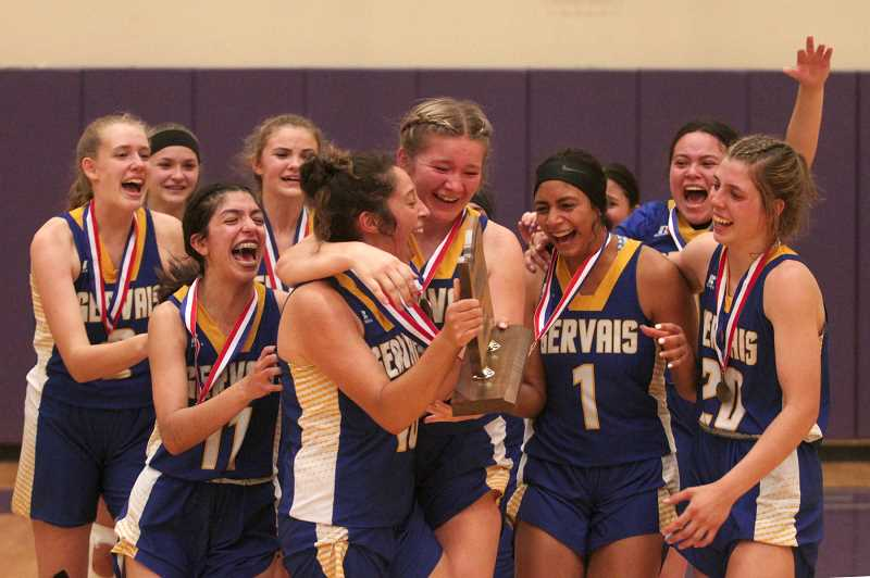 PMG PHOTO: PHIL HAWKINS - The Gervais girls basketball team finished the shortened 2021 season with a 12-0 record, including a 49-41 victory over Salem Academy in the championship game of the 2A showcase tournament at Ridgeview High School on Saturday.