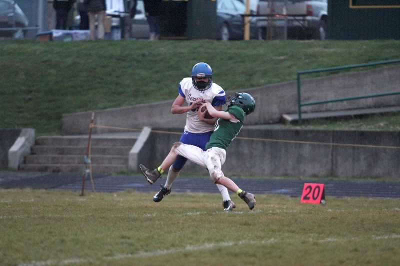PMG PHOTO: PHIL HAWKINS - Gervais senior Auggie Guido fights to retain the ball against Colton junior Jackson English in the first quarter. Guido finished with two catches for 77 yards and a touchdown. Guido signed with the College of the Siskiyous to play football.