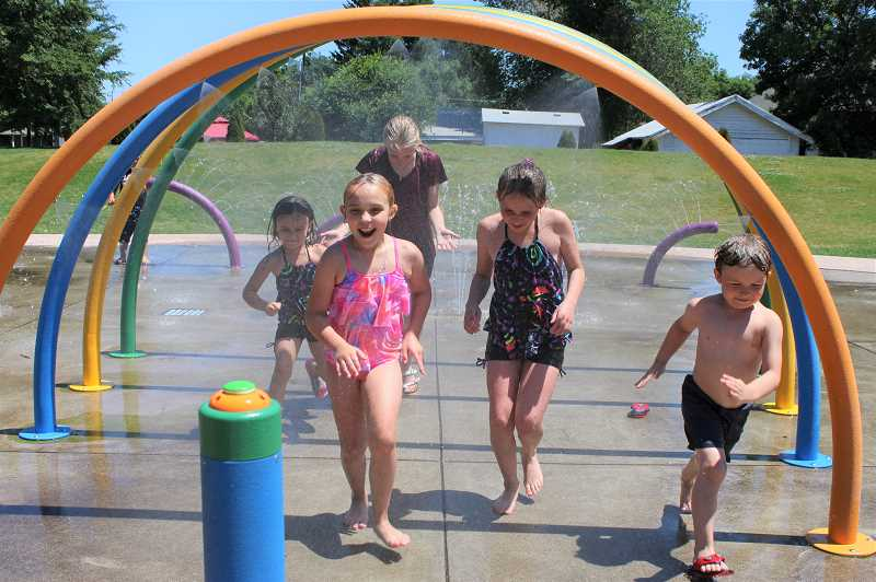 PAT KRUIS/MADRAS PIONEER  - The Ethan Stovall Spray Park at Sahalee Park Monday made a hot day fun for (left to right) Aspen Palmer Ross (5), Trinity Lechner (14), Abigail Ross (9), Sophia Lechner (12) and Zadyn LaPorte (6).