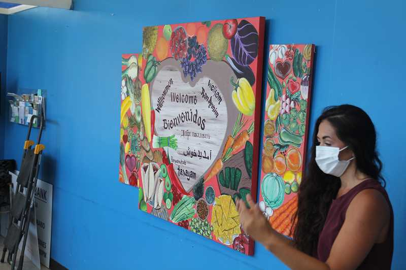 PMG PHOTO: JUSTIN MUCH - AWARE Food Bank Coordinator Gabby Pena discusses the new mural at the bank, provided by Oregon Youth Authority students from MacLaren. The youth worked on the project Friday afternoons over the course of several months.