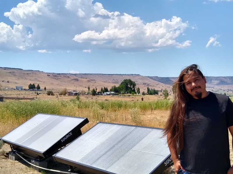 PAT KRUIS/MADRAS PIONEER  - These solar panels provide free drinking water for Warner Williams Jr. and his family, who live on the Warm Springs Reservation. The panels pull the moisture from the air, distill it into water then pump it to a special faucet in their house.