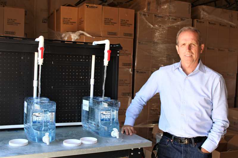 PAT KRUIS/MADRAS PIONEER  - Jim Souers, chief executive officer of the Warm Spring Economic Development Corporation, says the SOURCE Global system provides 150 gallons of drinking water per day. He hopes to enlarge the system to provide 750 gallons per day.