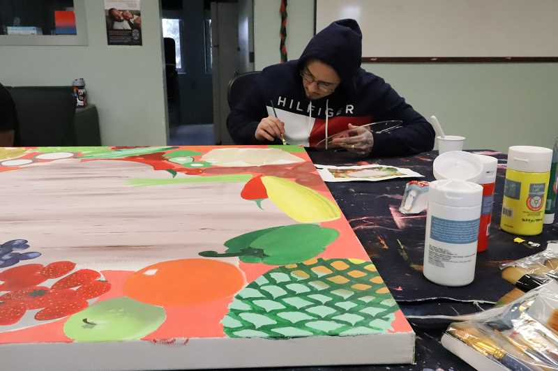 COURTESY PHOTO: OREGON YOUTH AUTHORITY - MacLaren student, Marco, works on a mural for the AWARE Food Bank in Woodburn. He shared a written statement of the joy and reward of working on the project, which was shared at the mural's unveiling by Javier Perfecto on Tuesday, June 29, 2021.