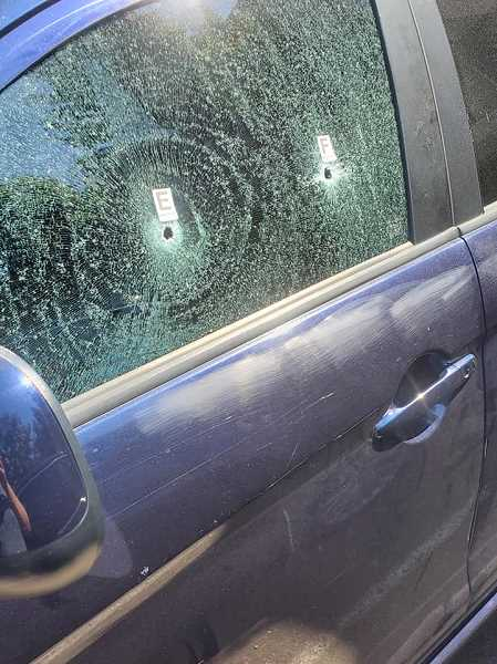 PHOTO COURTESY: MISTY GARRETT - A car with bullet holes was marked by police after a man opened fire on cars and apartments early Tuesday, June 29 in Southwest Portland.