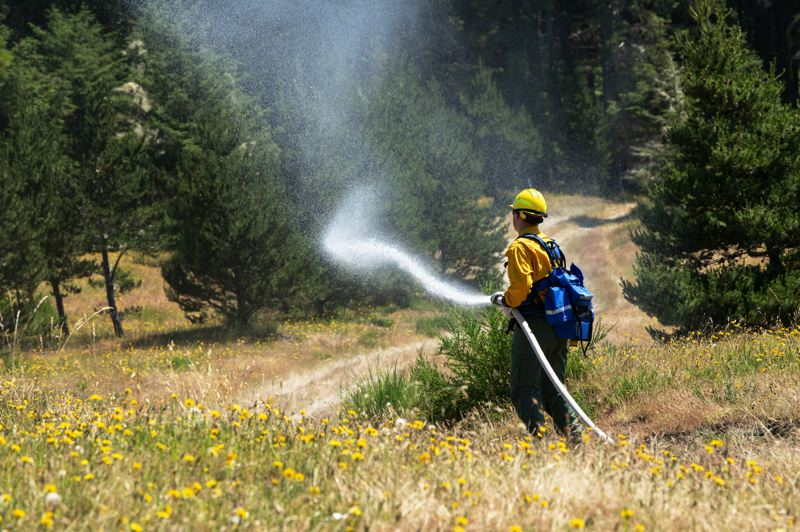 COURTESY PHOTO: MASTER SGT. JOHN HUGHEL, OREGON MILITARY DEPARTMENT - Oregon National Guard soldiers and airmen trained to fight wildfires in late June at Warrenton's  Camp Rilea.