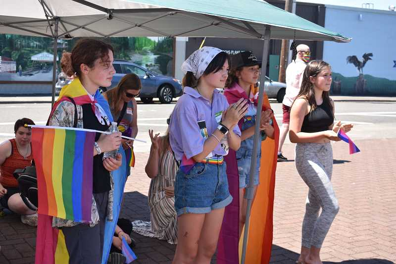 PMG PHOTO: STEVEN BROWN - Participants at a June 2021 SAFE event in downtown Sandy braved afternoon heat for a Pride event. Even with annual Pride events and moves to make schools more inclusive, students say changes to curriculum and counseling supports are needed.