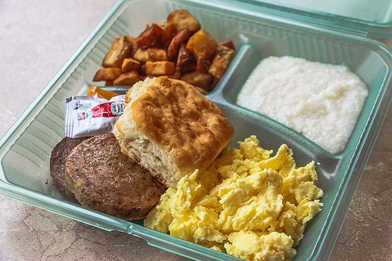 COURTESY PHOTO: MARION COUNTY - Immanuel Lutheran Church in Woodburn switched to reusable containers for its free Wednesday dinners, which will serve to save money and reduce trash.