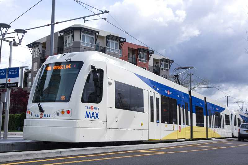 PMG FILE PHOTO - Large apartment buildings are sprouting up along most of TriMet light-rail line to Milwaukie, but Clackamas County commissioners have yet to update zoning codes allowing car lots at the end of the line in Oak Grove.
