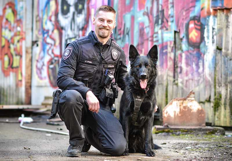COURTESY PHOTO: OCPD - Officer of the Year Jason Pohl is partnered with Oregon City's first and only narcotics detection dog, Grendel.