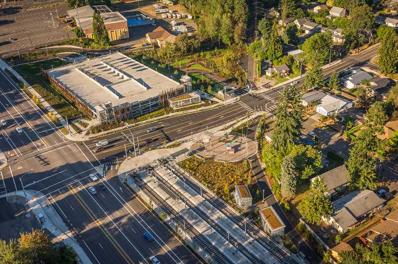 COURTESY PHOTO: TRIMET - An aerial view of the Park Avenue light-rail station shows nearby single-family residences, the park-and-ride garage and another large parking lot above it (top left).