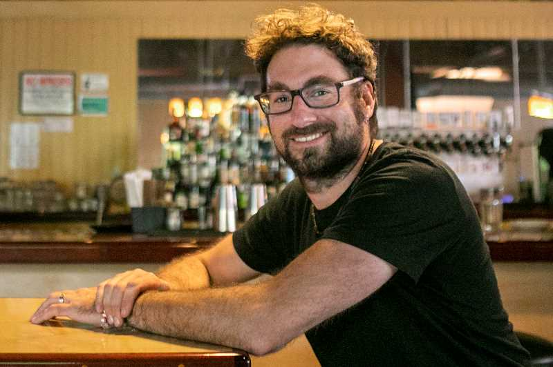 PMG PHOTO: JAIME VALDEZ - Chris Sjolin, one of the owners of Cooper Mountain Ale Works, has endured a roller coaster of a year since taking ownership of Max's Fanno Creek Brew Pub a year ago.