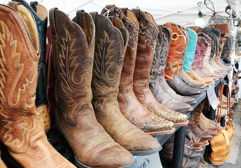 PMG PHOTO: GARY ALLEN - All manner of wares, including custom made cowboy boots, are for sale on the rodeo midway.