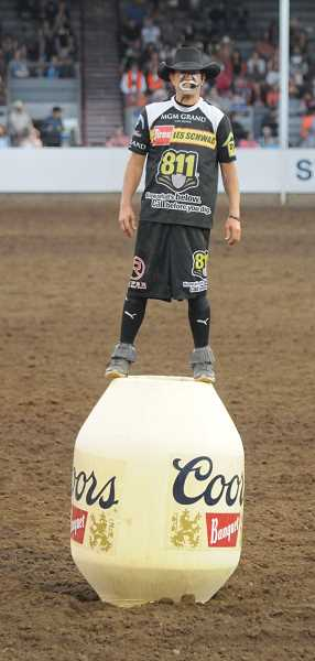 PMG PHOTO: GARY ALLEN - Rodeo clown J.J. Harrison entertains during an evening performance of the rodeo on Wednesday.