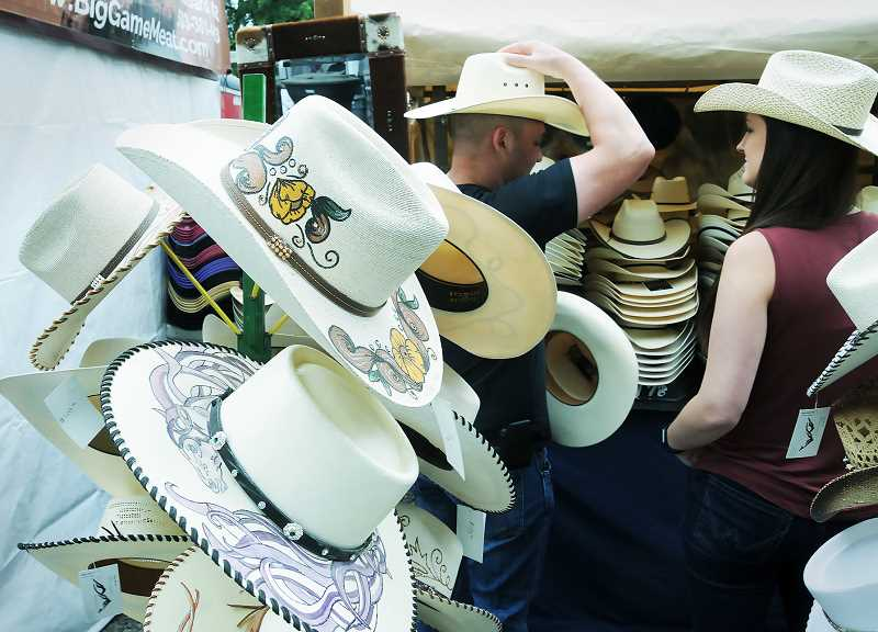 PMG PHOTO: GARY ALLEN - Cowboy hats are always a favorite among the wares for sale in the carnival midway.