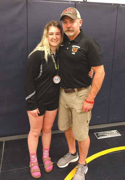 COURTESY PHOTO: NATHAN SMYTH - Molalla wrestling coach Nathan Smyth with Haley Hewlett after her state tournament run to fourth place.