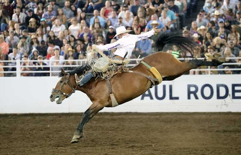 COURTESY PHOTO: RUTH NICOLAUS - Shorty Garrett, Eagle Butte, S.D., rides Corey and Lange Rodeos horse Pine Ridge for 83 points and the lead at the St. Paul Rodeo. The rodeo continues through July 4. Photo by Hoot Creek.