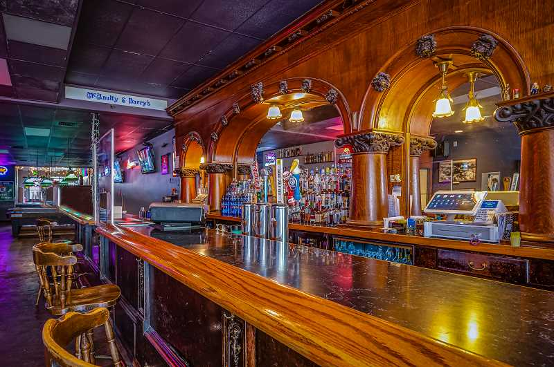 COURTESY PHOTO: LARA JANZEN - McAnulty & Barry's back bar was built and shipped from New England around the late 1800s or early 1900s.