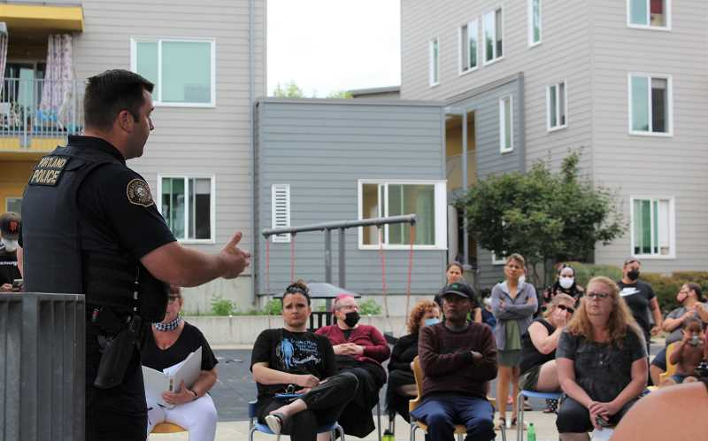 PMG PHOTO: COURTNEY VAUGHN - Portland Police Acting Sergeant Matt Jacobsen addresses residents of a Southwest Portland apartment complex where a gunman opened fire several times. Jacobsen attended the community meeting to address safety concerns among residents.