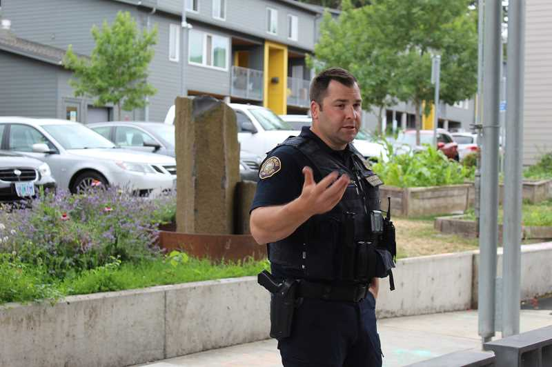 PMG PHOTO: COURTNEY VAUGHN - Matt Jacobsen, acting sergeant with the Portland Police Bureau, addresses residents during a community meeting at Stephens Creek Crossing Thursday, July 2.