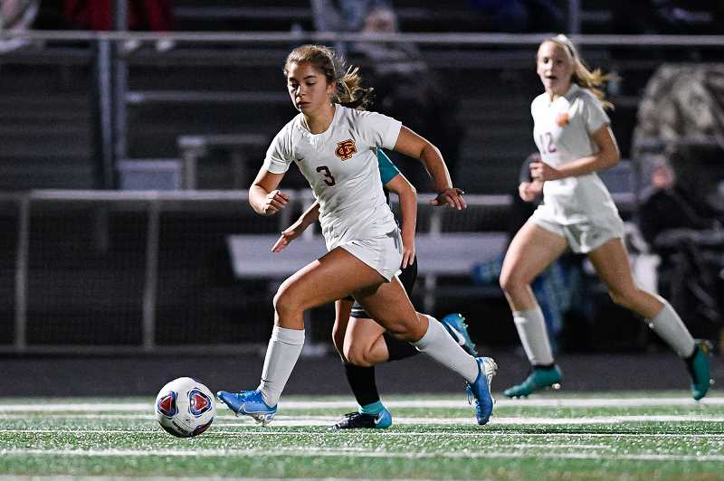 PMG PHOTO - Forest Grove's Makaila Takahashi runs the pitch during a Viking soccer game last year. The junior has three times earned all-league honors.
