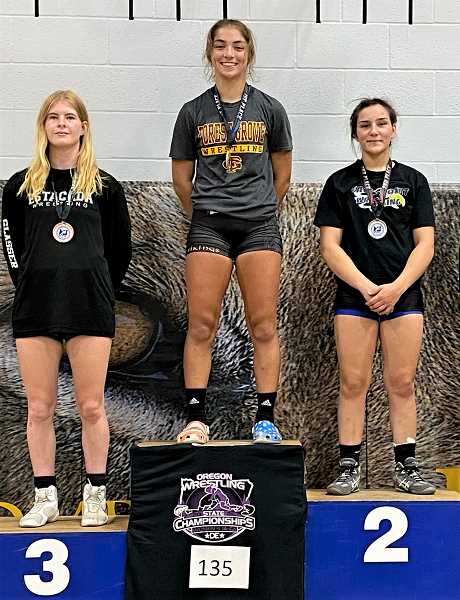 COURTESY PHOTO - Forest Grove's Makaila Takahashi (middle) accepts her first place medal during the OWA state wrestling championships last month.