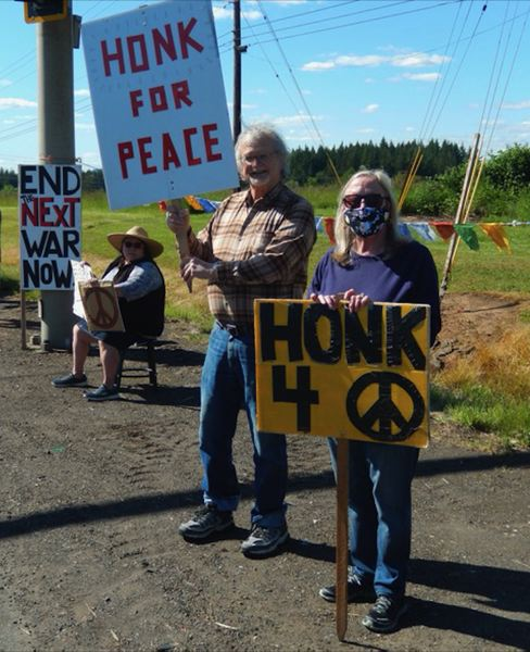 COURTESY PHOTO - Participants often held signs asking for 'honks for peace' and to 'end war now.'