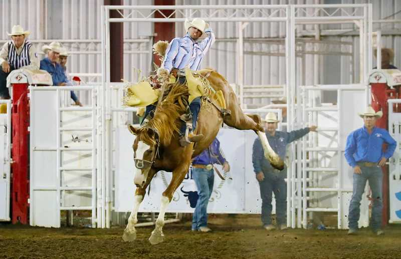 COURTESY PHOTO: ST. PAUL RODEO - Rookie Kade Bruno, Challis, Idaho, leads the saddle bronc riding with a score of 84.5 points after the third night of action at the St. Paul Rodeo. Photo by Hoot Creek.