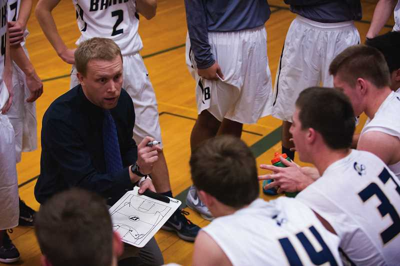 NEWS-TIMES PHOTO: KENT FRASURE - Banks boys basketball coach Marc Roche discusses strategy with his players during a practice during his first season at Banks. Roche recently accepted the head coaching job at Forest Grove High School.