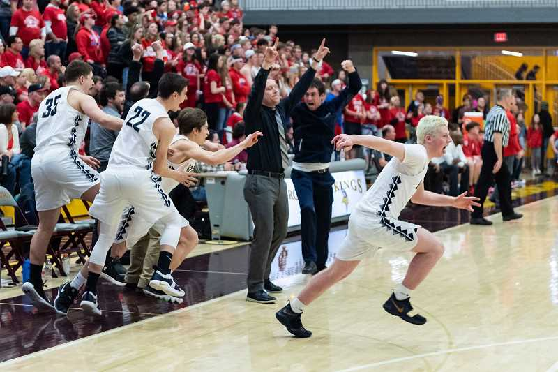PMG PHOTO: CHRISTOPHER OERTELL - Banks basketball coach Marc Roche celebrates with his team moments after winning the 2019 4A state basketball championship versus Seaside. Roche recently accepted the head coaching position at Forest Grove High School.