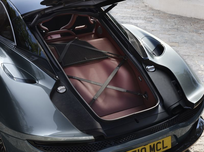 COURTESY MCLAREN - McLaren says the additional cargo space under thre rear hatch helps make its new model a GT. A custom set of luggge is designed to fit there, including a golf bag.