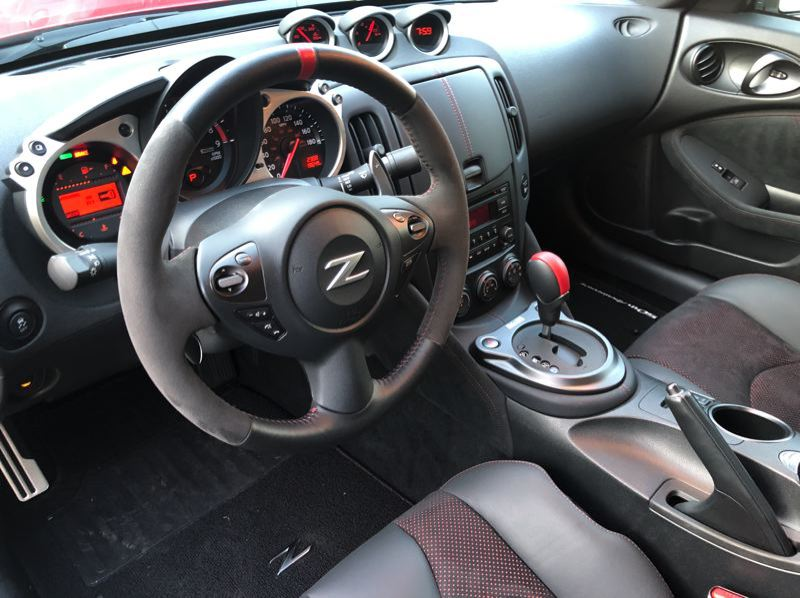 PMG PHOTO: JEFF ZURSCHMEIDE - The interior of the 2020 Nissan 370Z is dated but the outgoing generation can be ordered with a manual or automatic transmission. 50th Anniversay edition shown here.