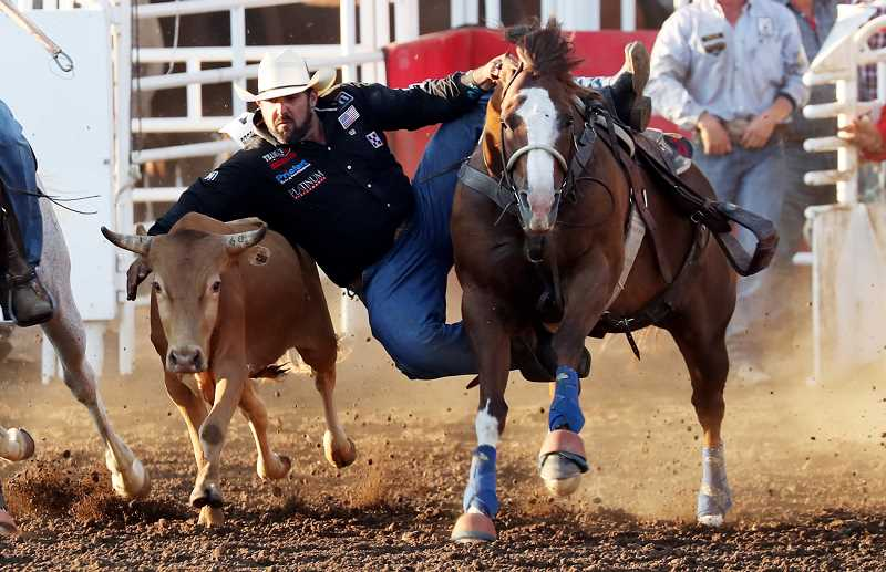 COURTESY PHOTO: HOOT CREEK/ST. PAUL RODEO - For the third time, California cowboy Luke Branquinho wins the steer wrestling at this year's St. Paul Rodeo, with a time of 8.4 seconds on two head.