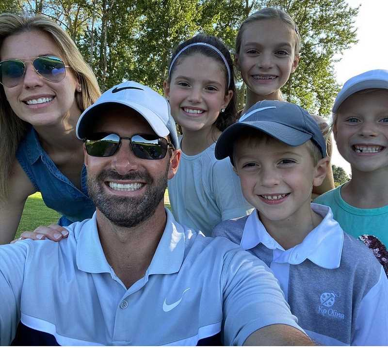 COURTESY PHOTO - Macklin Mucha (front right) poses for a photo with his father (Larry), mother (Kelly) and his three sisters. Macklin loves playing golf with his dad who got him into the game when he was 3-years-old.