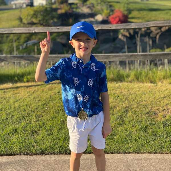 COURTESY PHOTO - Macklin Mucha poses for a photo with one his many first-place medals. Macklin has won more than 25 events at the age of six.