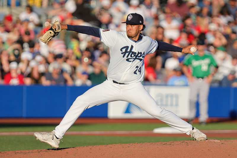 PMG PHOTO: JONATHAN VILLAGOMEZ - Hops pitcher Kenny Hernandez hurls a pitch during Hillsboro's win over Eugene Sunday, July 4, at Ron Tonkin Field. Hernandez was dominant, throwing seven shutout innings, allowing just three hits while striking out nine.