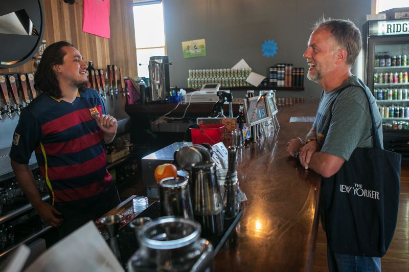 PMG PHOTO: JAIME VALDEZ - Pablo Campos, general manager at Ridgewalker Brewing Company, left, Chats with Ian Clemons of Gaston at the brewery in Forest Grove. Both gentleman are seen mask-less after the mask requirement was lifted on June 30.