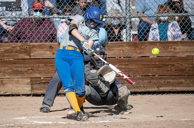 CENTRAL OREGONIAN - Emma Lees, shown her ripping a double early in the Cowgirls' season, was named to the Intermountain Conference first team as a utility player. Lees hit .533 during the IMC season. The senor was also honorable mention all- state. Cowgirl head coach Jeremy Puckett was also named IMC co-coach of the year.