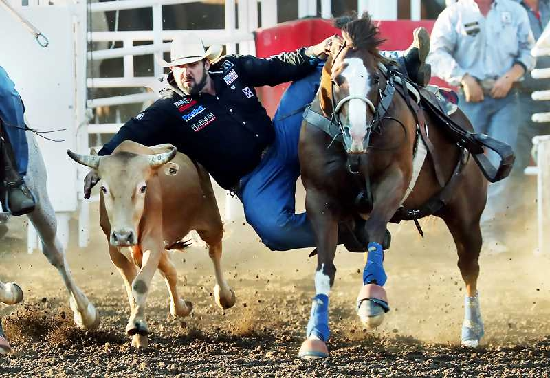 COURTESY PHOTO: HOOT CREEK - Luke Branquinho earned first place in steer wrestling at the St. Paul Rodeo, overcoming a hamstring injury that has hampered his performances over the past several weeks.