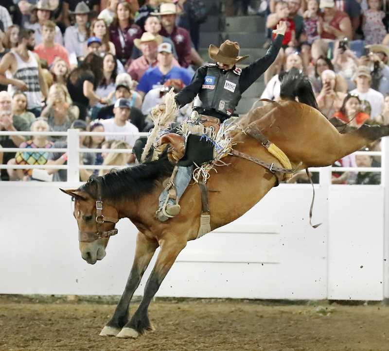 COURTESY PHOTO: HOOT CREEK - Zeke Thurston, a two-time PRCA world champion, finished first in St. Paul with a total of 88 points on a horse named Broken Camp.