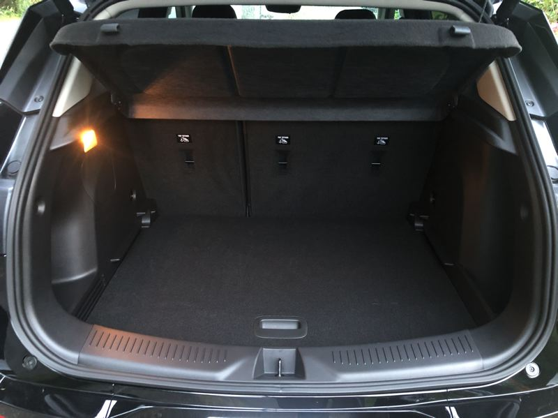 PMG PHOTO: JEFF ZURSCHMEIDE - The Encore GX is a functional SUV. You can stuff 50.2 cubic feet of cargo in the back, or 23.5 cubic feet with the rear seats up.