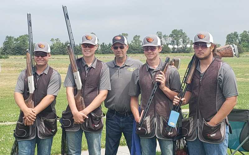 COURTESY PHOTO  - Jefferson County residents on the Oregon 4-H shotgun shooting team, which traveled to Nebraska to compete in the 4-H Shooting Sports National Championships, included, from left, Carson King, Logan Lee, Coach Kevin Tollefson, James Lange and Seth Colton.