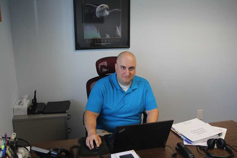 PMG PHOTO: JUSTIN MUCH - Ryan Smith was hired as the new executive director at the Woodburn nonprofit Love INC in June.