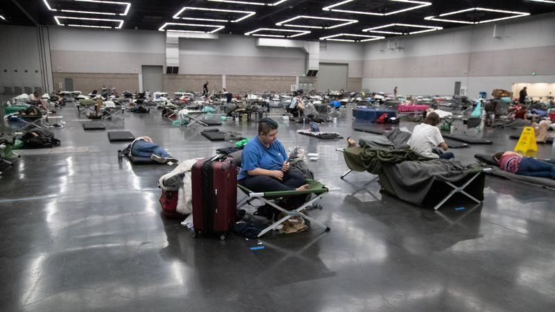 MULTNOMAH COUNTY PHOTO: MOTOYA NAKAMURA - People shelter inside the Oregon Convention Center during the historic heatwave last month.