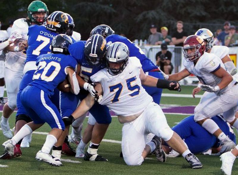 COURTESY PHOTO: ROB BYNUM - Wilsonville senior lineman Aaron Wilcox (no. 75) tries to make a tackle of Thurston's Gavin Knights during the South's 31-8 win over the North in the Les Schwab Bowl at Linfield College in McMinnville on Saturday, July 3.