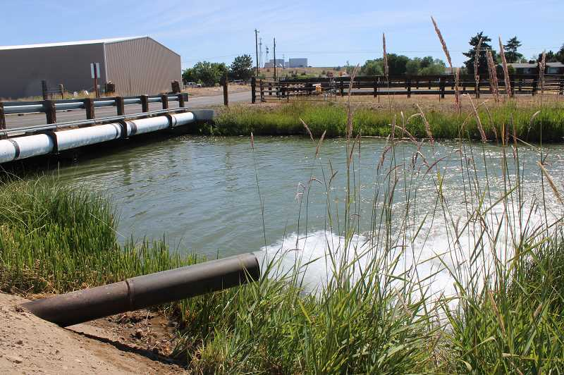 PAT KRUIS/MADRAS PIONEER - Water from the Deschutes Valley Water District flows directly into the North Unit Irrigation District canal. For the first time, DVWD is selling water for irrigation. The 2021 drought has forced NUID to search everywhere to bring water to its farmers.