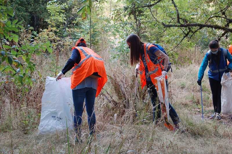 COURTESY PHOTO: WES - At an event hosted by Clackamas Water Environment Services, 20 volunteers collected 300 pounds of litter in August 2020 at 3-Creeks Natural Area in Milwaukie.