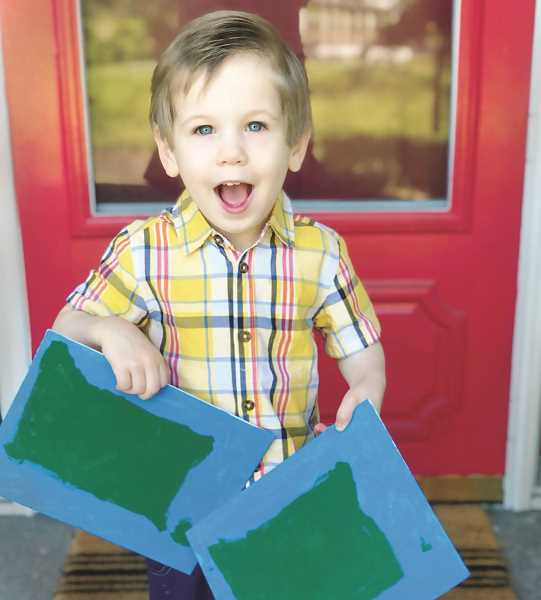 COURTESY PHOTO: SARA LAWSON - Three-year-old Lawson Lundberg recently became a member of Mensa after scoring 151 on an IQ test. He also has stretched his artistic skills by creating paintings of the outlines of states.